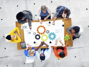 Teamcoaching: a team working at a table